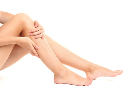 legs: woman holding sore leg, isolated on white