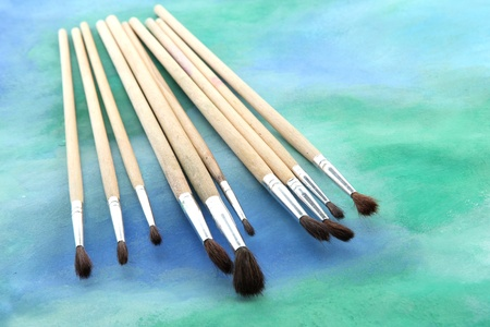 brushes on bright abstract gouache painted background Stock Photo - 15048575