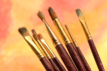 brushes on bright abstract gouache painted background Stock Photo - 15048456