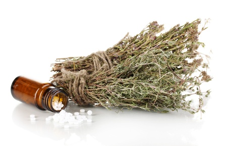 bottle of medicines with herbs on white background. concept of homeopathy Stock Photo - 15048042