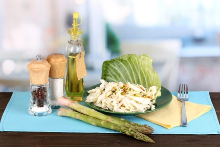 nutritiously: Plate with coleslaw and seasonings on wooden table on room background Stock Photo