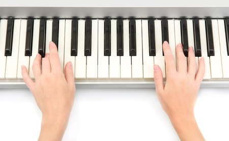 hands of woman playing piano photo
