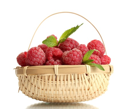 ripe raspberries in basket with mint  isolated on white Stock Photo - 15116371