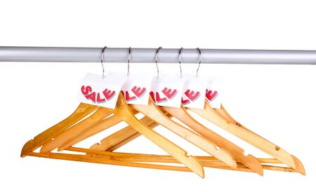 cloakroom: wooden clothes hangers as sale symbol isolated on white Stock Photo