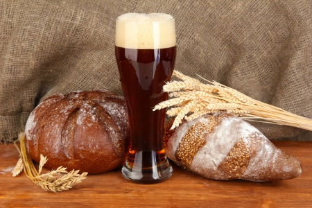 glass of kvass with bread on canvas background close-up photo