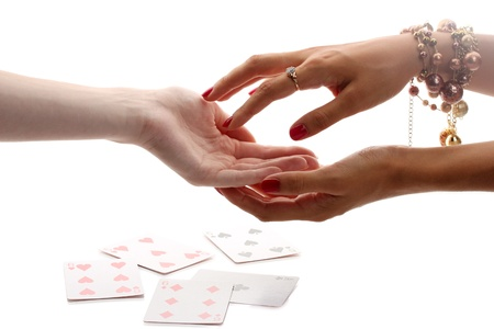 psychic reading: reading the lines hand in a womans hands isolated on white