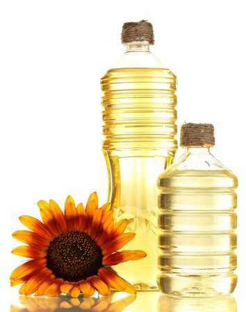 oil in bottles and sunflower, isolated on white photo