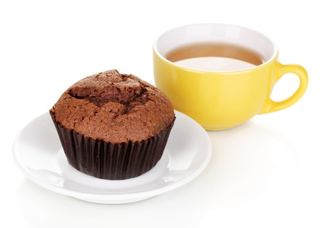Fresh muffin with tea isolated on white photo