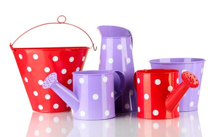 Purple and red watering cans and buckets with white polka-dot isolated on white Stock Photo - 15492226