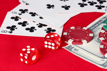 The red poker table with playing cards. The combination of flush photo
