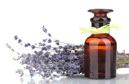 lavendin: Lavender flowers and glass bottle isolated on white Stock Photo