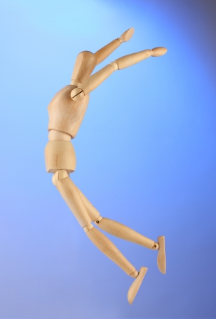 wooden mannequin, on blue background Stock Photo - 15496549