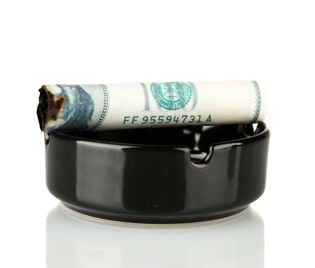 Cigar of the 100 dollar bill and an ashtray isolated on white Stock Photo - 15505785