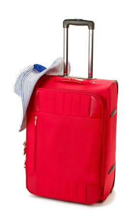 luggage pieces: Red suitcase with womans hat isolated on white