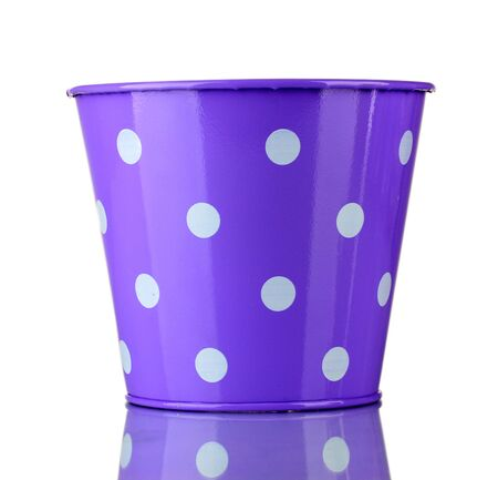 Purple bucket with white polka-dot isolated on white photo