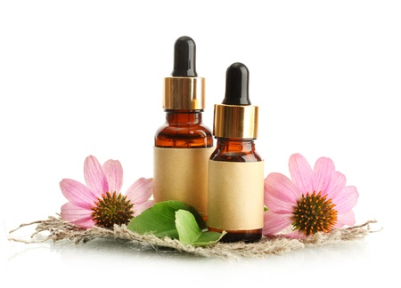 homeopathic: bottles with essence oil with purple echinacea , isolated on white