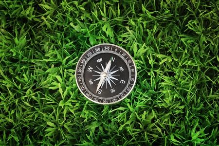 compass on green grass Stock Photo - 15249484