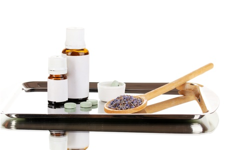 Alternative therapies on the silver tray isolated on white background close-up photo