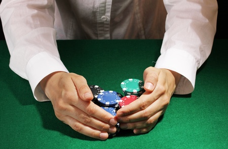 Taking win in poker on green table photo