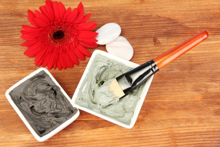 cosmetic clay for spa treatments on wooden background close-up photo