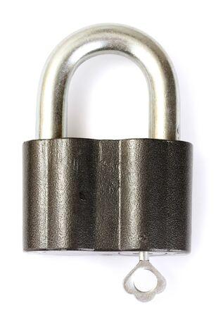 old padlock with key isolated on white background photo