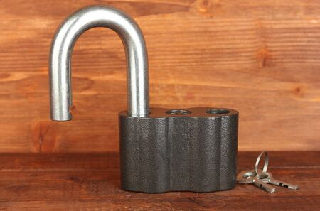 old padlock with keys on wooden background close-up Stock Photo - 15410250