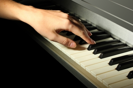 hand of woman playing piano photo