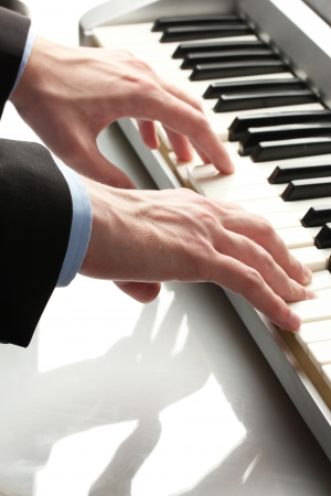 octave: hands of man playing piano