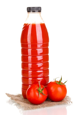 Tomato juice in bottle on sackcloth isolated on white photo