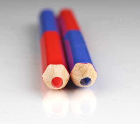 allocate: Red and blue pencils close-up isolated on white Stock Photo