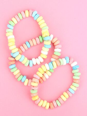 sugar paste: Color candies on rope on pink background