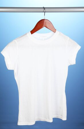 White t-shirt on hanger on blue background Stock Photo - 15368695