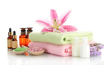 towels with lily, aroma oil, soap and sea salt isolated on white Stock Photo - 15368500