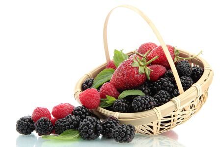 mellow: beautiful berries with leaves in basket isolated on white