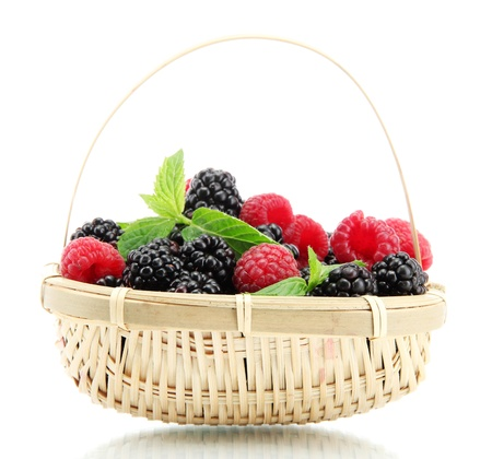black raspberries: beautiful berries with leaves in basket isolated on white
