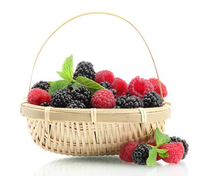 beautiful berries with leaves in basket isolated on white photo