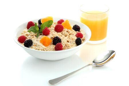 tasty oatmeal with berries and glass of juice, isolated on white Stock Photo - 15368230