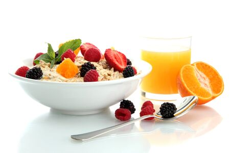 tasty oatmeal with berries and glass of juice, isolated on white Stock Photo - 15368399
