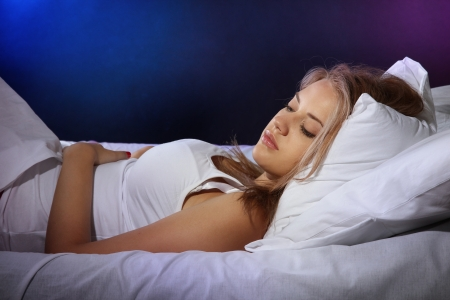 dark blond: young beautiful woman sleeping on bed in bedroom