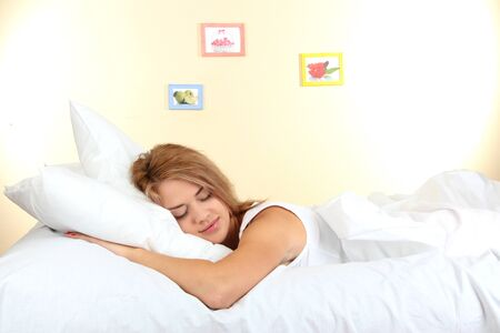 young beautiful woman sleeping on bed in bedroom Stock Photo - 17187047