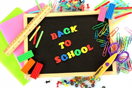 Small chalkboard with school supplies on white background. Back to School Stock Photo - 15410422