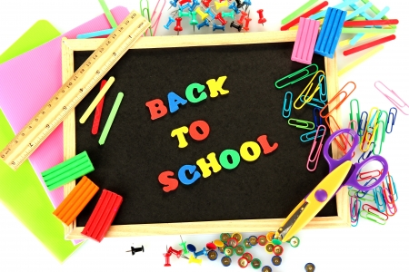 Small chalkboard with school supplies on white background. Back to School Stock Photo - 15410399