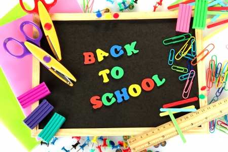 Small chalkboard with school supplies on white background. Back to School Stock Photo - 15410361