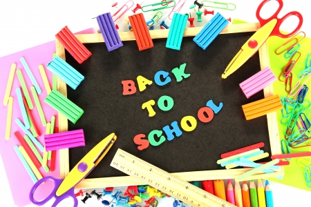 Small chalkboard with school supplies on white background. Back to School Stock Photo - 15410409