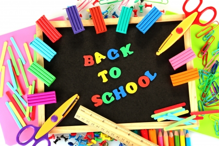 Small chalkboard with school supplies on white background. Back to School Stock Photo - 15410272
