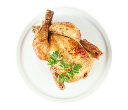 Roasted whole chicken on a white plate isolated on white Stock Photo - 15388028