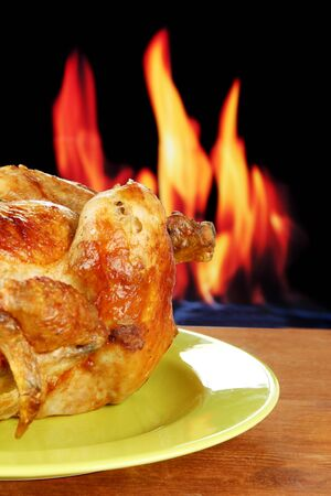 Roasted whole chicken on a green plate on wooden background close-up Stock Photo - 15390928