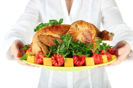 Chef holding a plate of baked chicken with vegetables close-up Stock Photo - 15374807