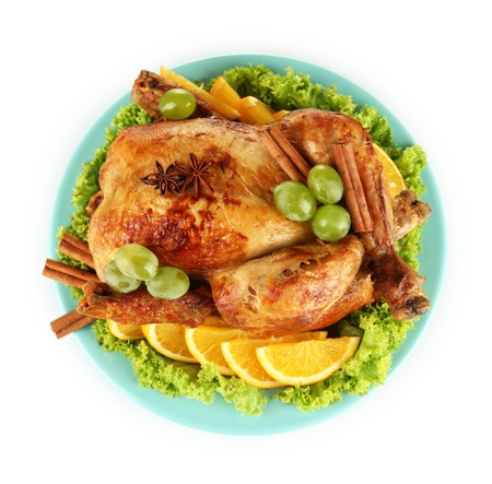 whole roasted chicken with lettuce, grapes, oranges and spices on blue plate isolated on white Stock Photo - 15388450