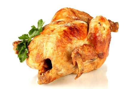 whole roasted chicken with parsley isolated on white Stock Photo - 15390956